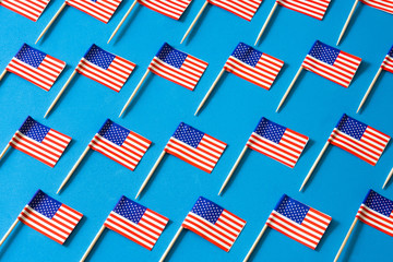 USA flags pattern on blue background