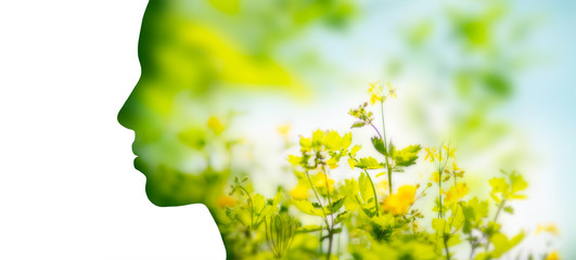 beauty, nature and ecology concept - portrait of woman profile with yellow spring flowers with...