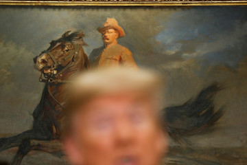 A painting of Theodore Roosevelt is seen behind U.S. President Donald Trump as he speaks before the signing ceremony for S. 2155 - Economic Growth, Regulatory Relief, and Consumer Protection Act in the Roosevelt Room at the White House in Washington