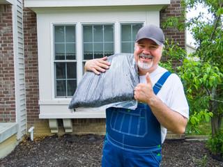 Happy gardener or or garden services worker