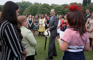 Britain's Prince Edward meets people during a day of DofE presentations at Buckingham Palace in London