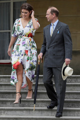 Britain's Prince Edward and Princess Eugenie arrive during a day of DofE presentations at Buckingham Palace in London