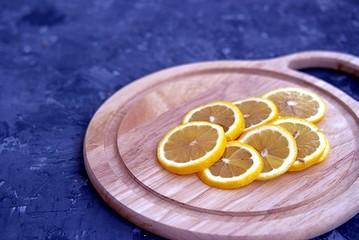 Sliced lemon on a wooden board