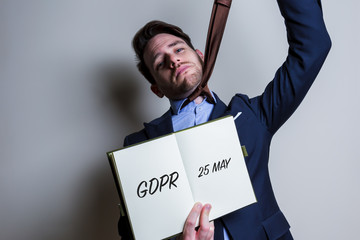 Nervous business man handle note with GDPR (General Data Protection Regulation) act title
