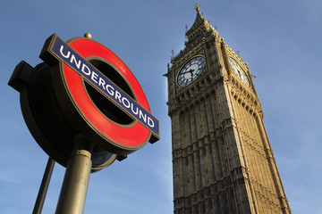 Low angle view of underground sign against Big Ben