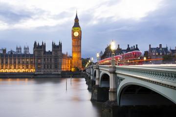 Westminster bridge over Thames river against Big Ben during sunset