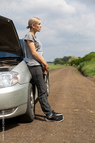 Car Broke Down >> The Girl S Car Broke Down The Girl Stands Near The Car With An Open