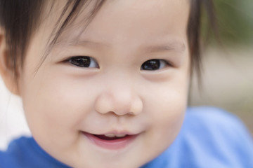 Close-up portrait of smiling baby girl