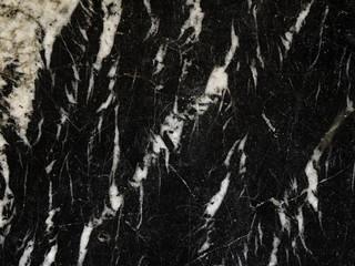 Old weathered black marble stone background