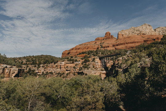 Scenic view of trees by rock formations against sky