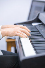 Pianist hands playing piano