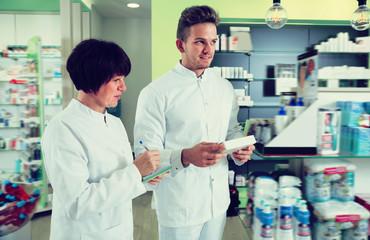 Portrait of two happy pharmacists