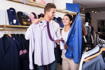 Couple choosing clothing at shop