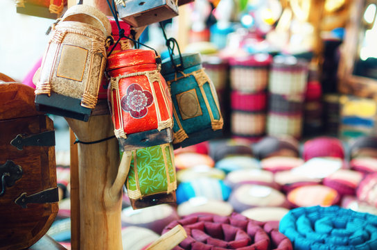 Traditional handcrafted thai rice boxes hanging from a market stall