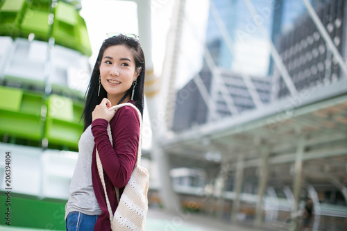 bbc54e75fd9 Summer sunny lifestyle fashion portrait of young stylish hipster Asia woman  walking on the street