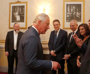 """Britain's Prince Charles speaks to dignitaries as he attends """"Platinum - Israel at 70"""", the Jewish community's celebration of the 70th Anniversary of the founding of the State of Israel at the Royal Albert Hall in London"""