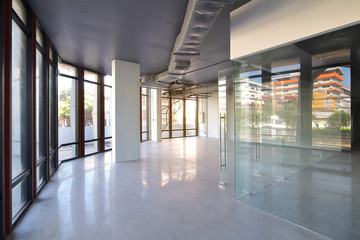 Bangkok,Thailand - October 19 , 2017 : Empty office room on modern building with sunlight and indoor ventilation system on hight ceiling of large building.