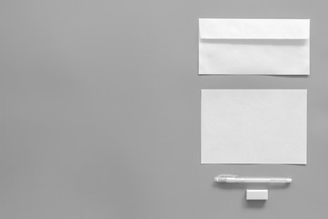 Mockup template for branding identity. White stationery on grey background top view copy space. Pattern