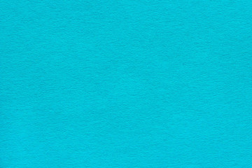 texture of the dense blue-turquoise paper