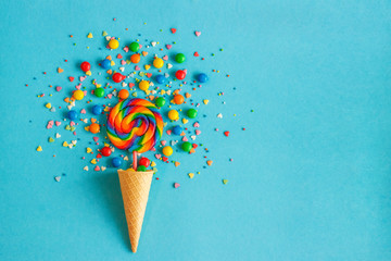 Ice cream cone with colorful lollipop and multicolored sweets. concept, , flat lay,  top view, copy space,