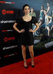 """Cast member Rossum poses at an event for the television series """"Shameless"""" in Los Angeles"""