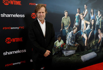 """Cast member Macy poses at an event for the television series """"Shameless"""" in Los Angeles"""