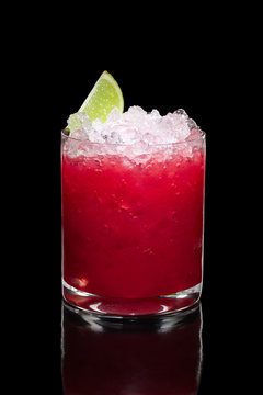 Cold strawberry cocktail with ice crush and lime