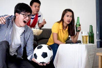 Group of friends fanclub watching soccer match on tv and cheering football team, celebrating with beer and popcorn at home, sports and entertainment concept