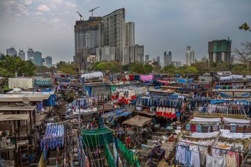 Dhobi Ghat Mumbai Laundry. Dhobi Ghat is a well known open air laundromat in Mumbai, India. The washers, known as dhobis, work in the open to clean clothes and linens from Mumbai's hotels and hospital