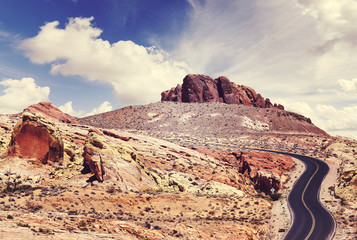 Vintage stylized picture of a scenic winding road, travel concept, Nevada, USA.