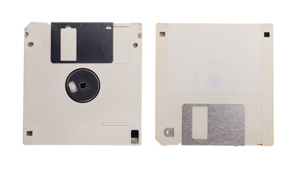 Obsolete technology - two used floppy discs isolated on white