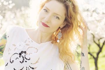 Beautiful woman in spring light garden