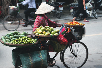 street vendor with bicycle in hanoi
