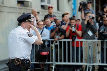 A police officer is seen in front of the 1st Precinct in Manhattan as film producer Harvey Weinstein is expected to arrive