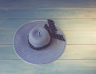 Woman's accessories seen from above, top view. Concept image. Women's hat on wooden
