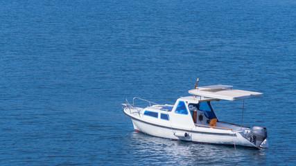 white boat in the blue sea