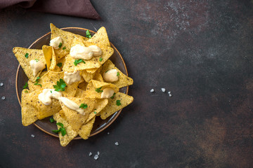 Nachos chips and cheese sauce