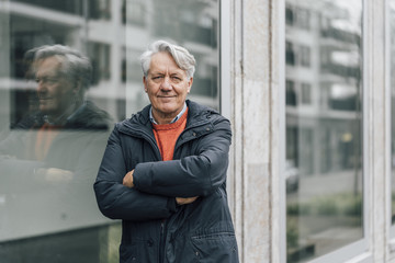 Portrait of confident senior man in the city