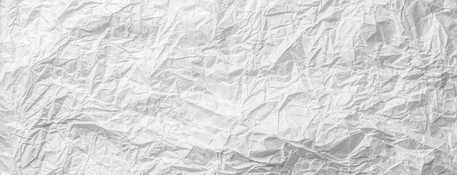 Background of crumpled white gray monochrome bakery paper