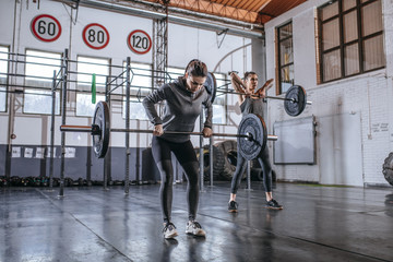 Sportswomen Lifting Weights