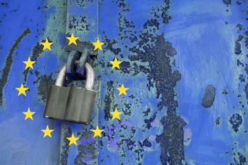 General Data Protection Regulation concept. Padlock on blue metal old door with the European Union flag of yellow stars.