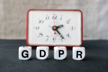 General Data Protection Regulation concept. Letters GDPR with red clock on the black background