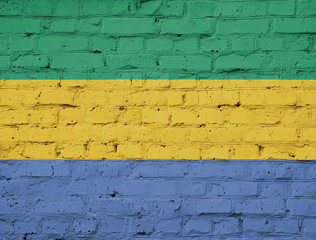 Texture of a flag of Gabon on a brick wall.