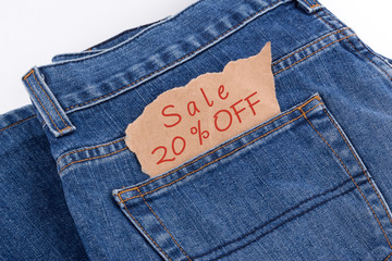 sale 20 percent OFF label in jeans pocket