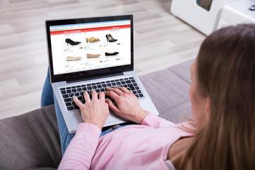 Woman Shopping Footwear's Online On Laptop