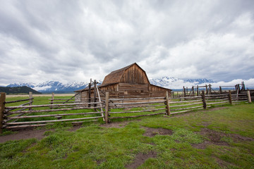 Log Cabin Barn in front of Mountains in the Grand Teton National Park