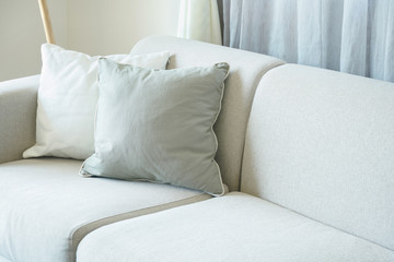 Light gray sofa with pillows in the living room