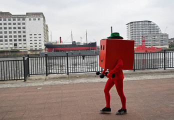 Attendees dressed as their favourite comic characters for the MCM London Comic Con, a convention to celebrate the culture of comic books and related art forms, gather in London, Britain