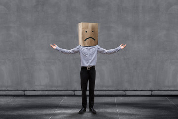 Customer Experience Concept, Unhappy Businessman Client with Sadness Emotion Face on Paper Bag, Arms up with meaning of Disappointed and Wondering. Concrete Wall as background