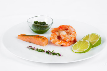 Slice of dried salmon with shrimps and lemon.